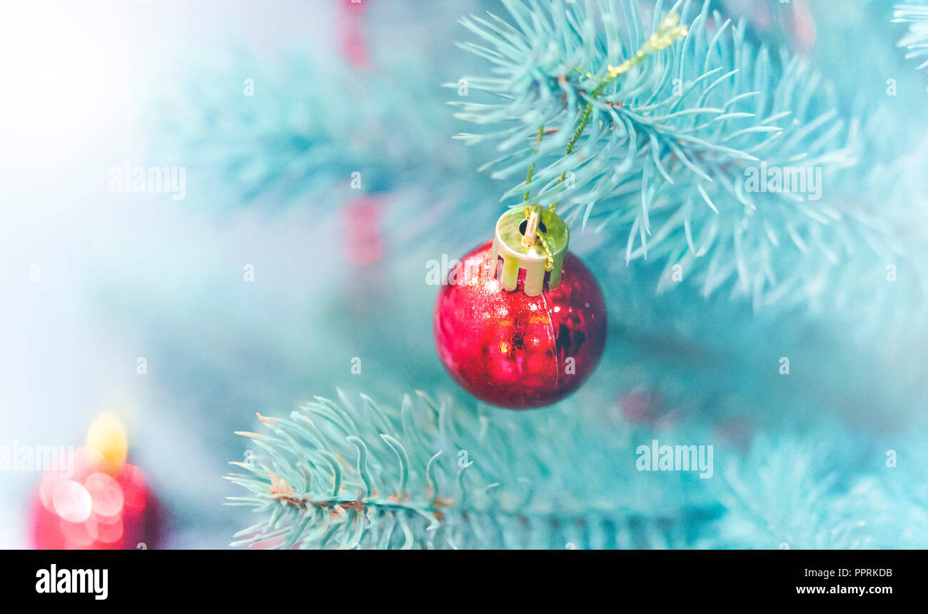 christmas tree toys decorations and snow covered christmas tree branches close up winter christmas new year background