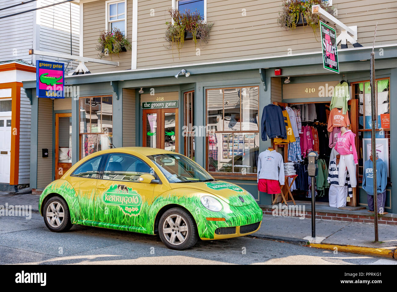 Yellow and Green  KerryGold Butter VW Beetle parked outside a store  , Newport Rhode Island Houses - Stock Image