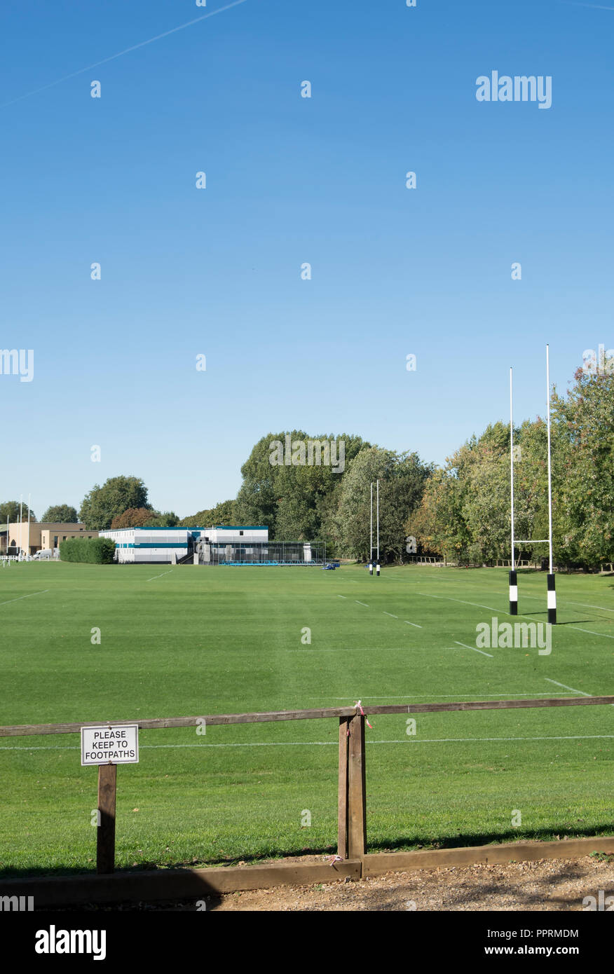 playing fields at st paul's school, barnes, london, england, with please keep to footpaths sign in foreground - Stock Image