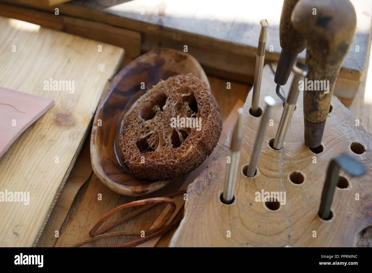 Editing and engraving leather is an old art of craftsmanship - Stock Image