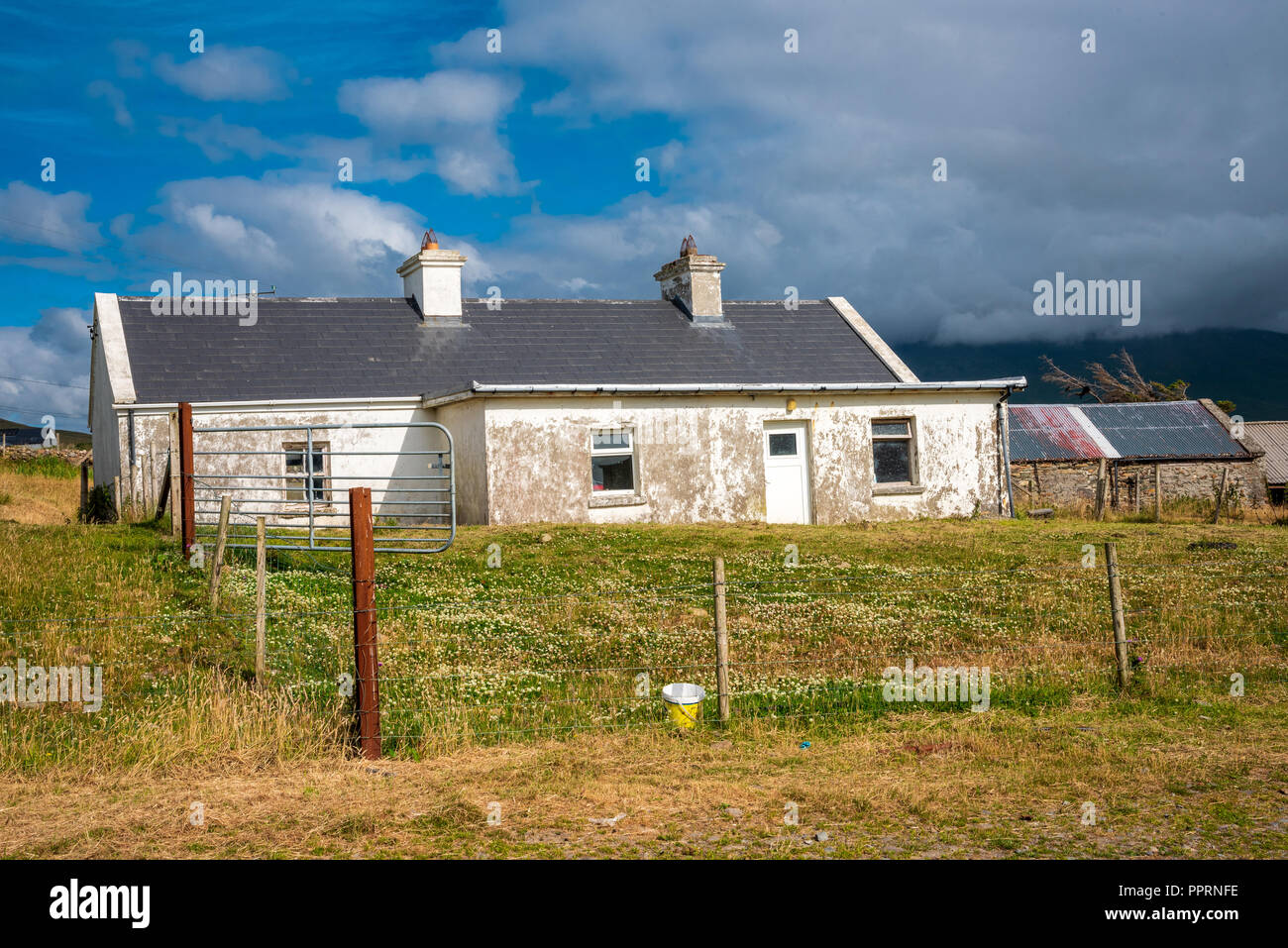 An old abandoned farmhouse on a hill in County Mayo, Ireland. - Stock Image