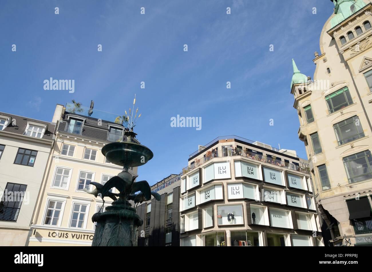 Copenhagen, Denmark - September 15, 2018:  Stork Fountain at  Amager Square surrounded by buildings in central Copenhagen, Denmark. - Stock Image