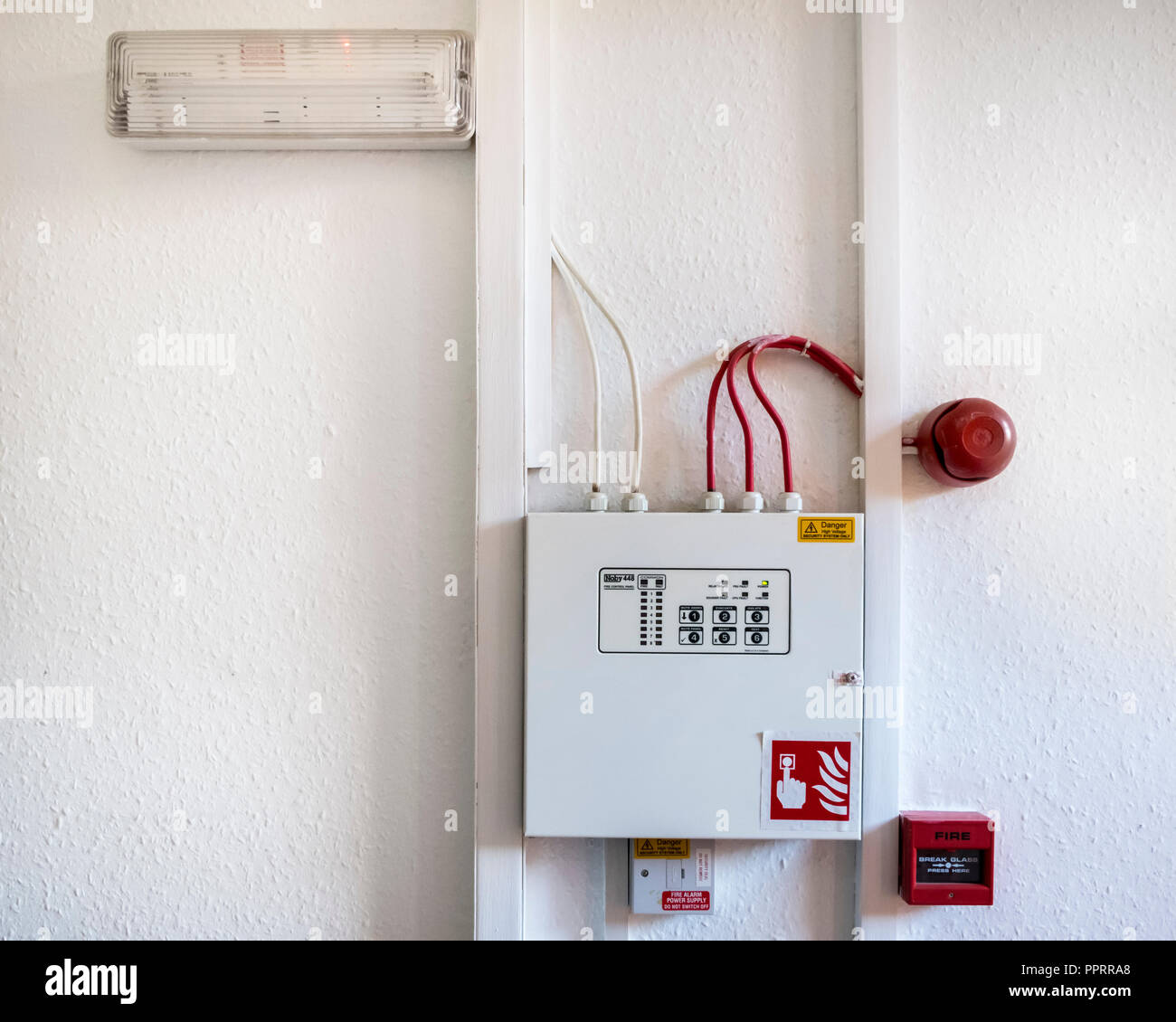 Fire alarm system with fire bell and safety light with a Noby 448 fire control panel - Stock Image