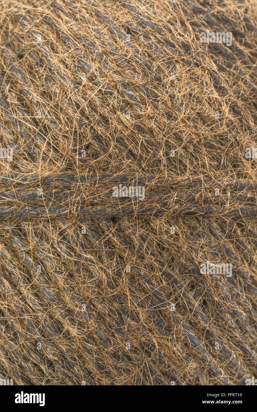 Natural tarred sisal garden twine / string. Great macro of individual fibres making up the twine. Metaphor 'How long is a piece of string?' - Stock Image