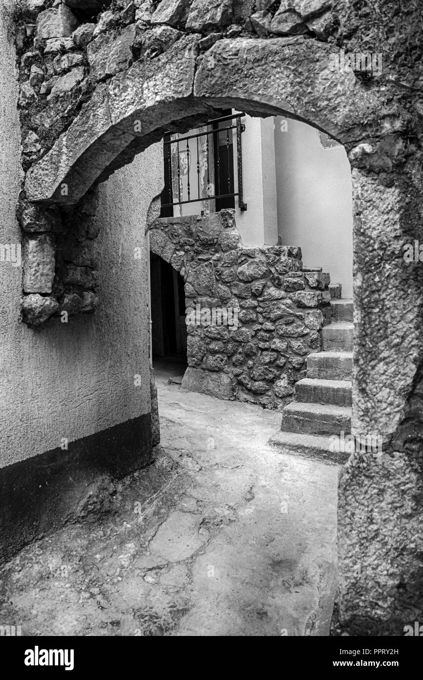 The interwoven stone labyrinths of bridges, stairs, alleys and houses in the medieval village of Vrbnik on the Croatian island of Krk on the Adriatic - Stock Image