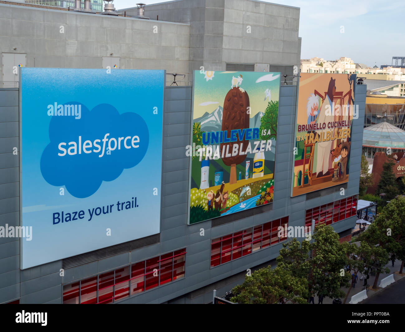 Salesforce with Unilever and Brunello Cucinelli billboards hanging in downtown San Francisco for Dreamforce conference - Stock Image
