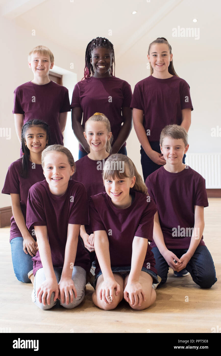Portrait Of Children Enjoying Drama Workshop Together - Stock Image