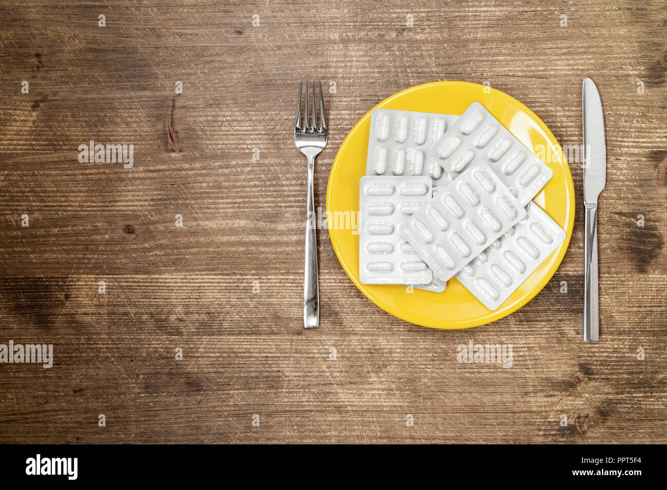 Pills ,drugs ,tablets,pharmaceutical on plate with fork and knife Stock Photo