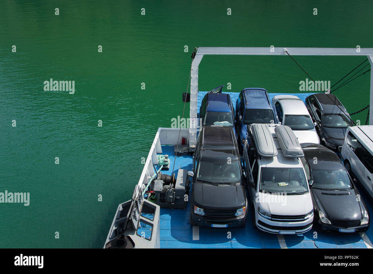 Vehicles parked on the ferry, space for text. Concepts - transportation and travel in security, support during the trip for all types of vehicles - Stock Image