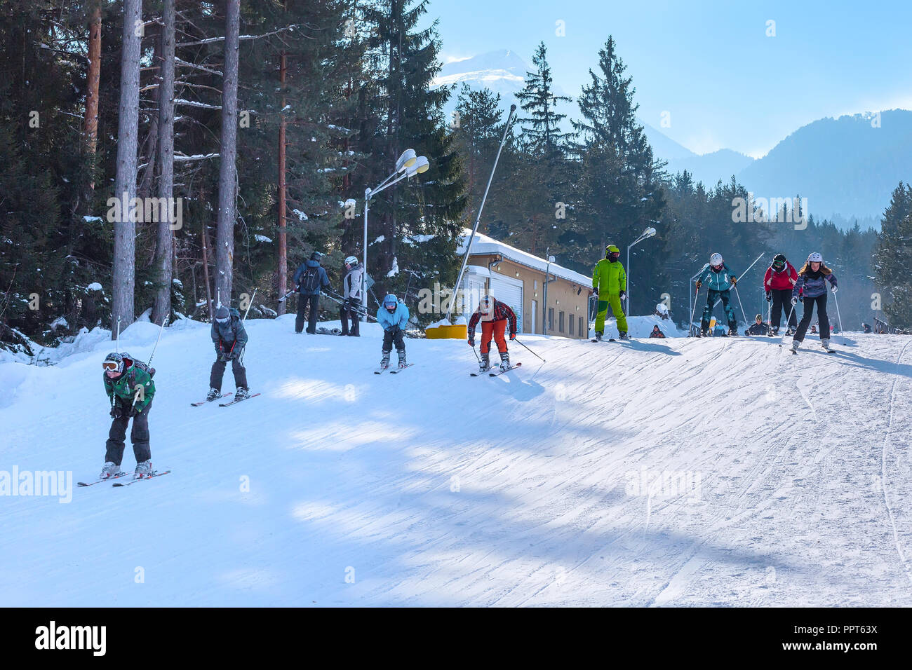 Bansko, Bulgaria - January 13, 2017: Winter ski resort Bansko, ski slope, people skiing and mountains view - Stock Image