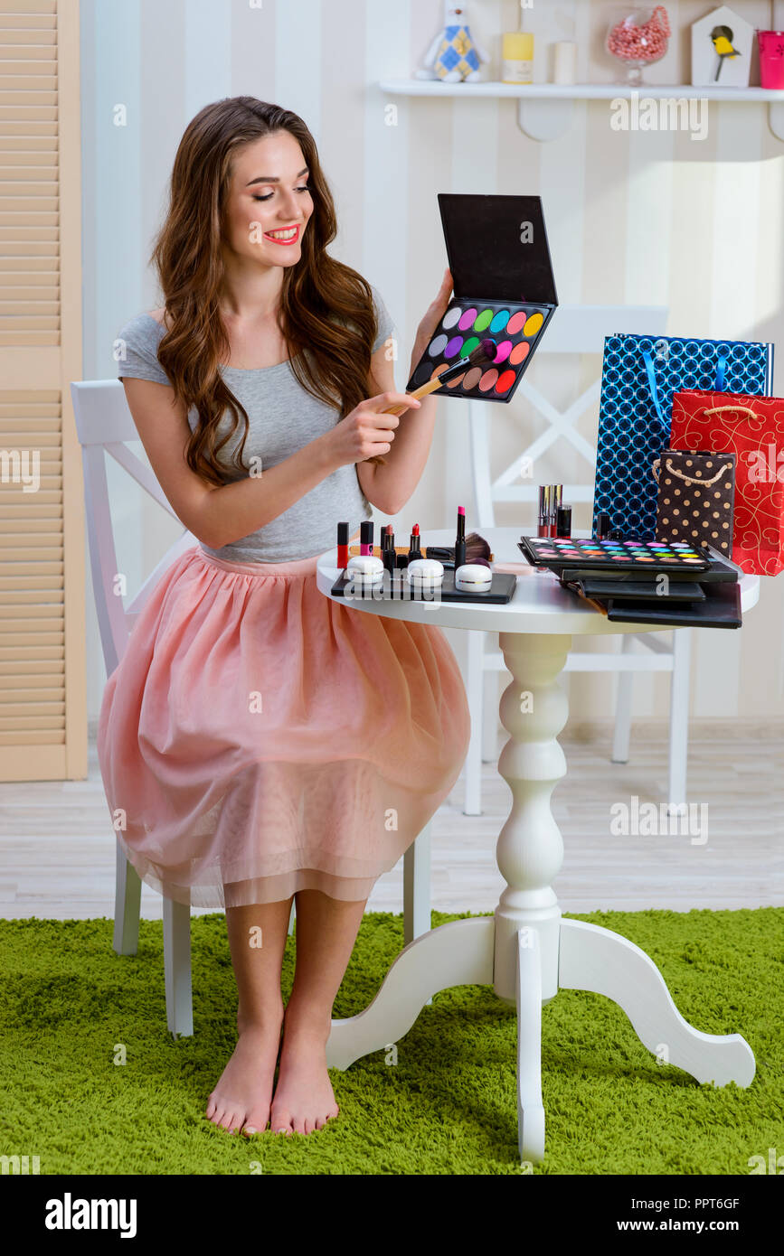 Holding eyeshadow makeup set - Stock Image