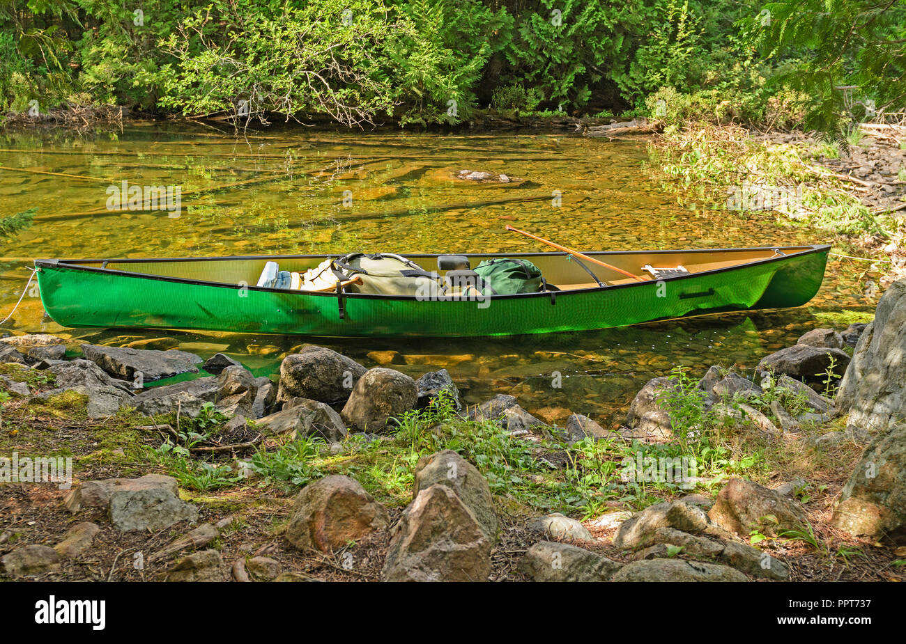 Canoe on a Remote Lake Shore on Agnes Lake in Quetico Provincial Park in Ontario - Stock Image