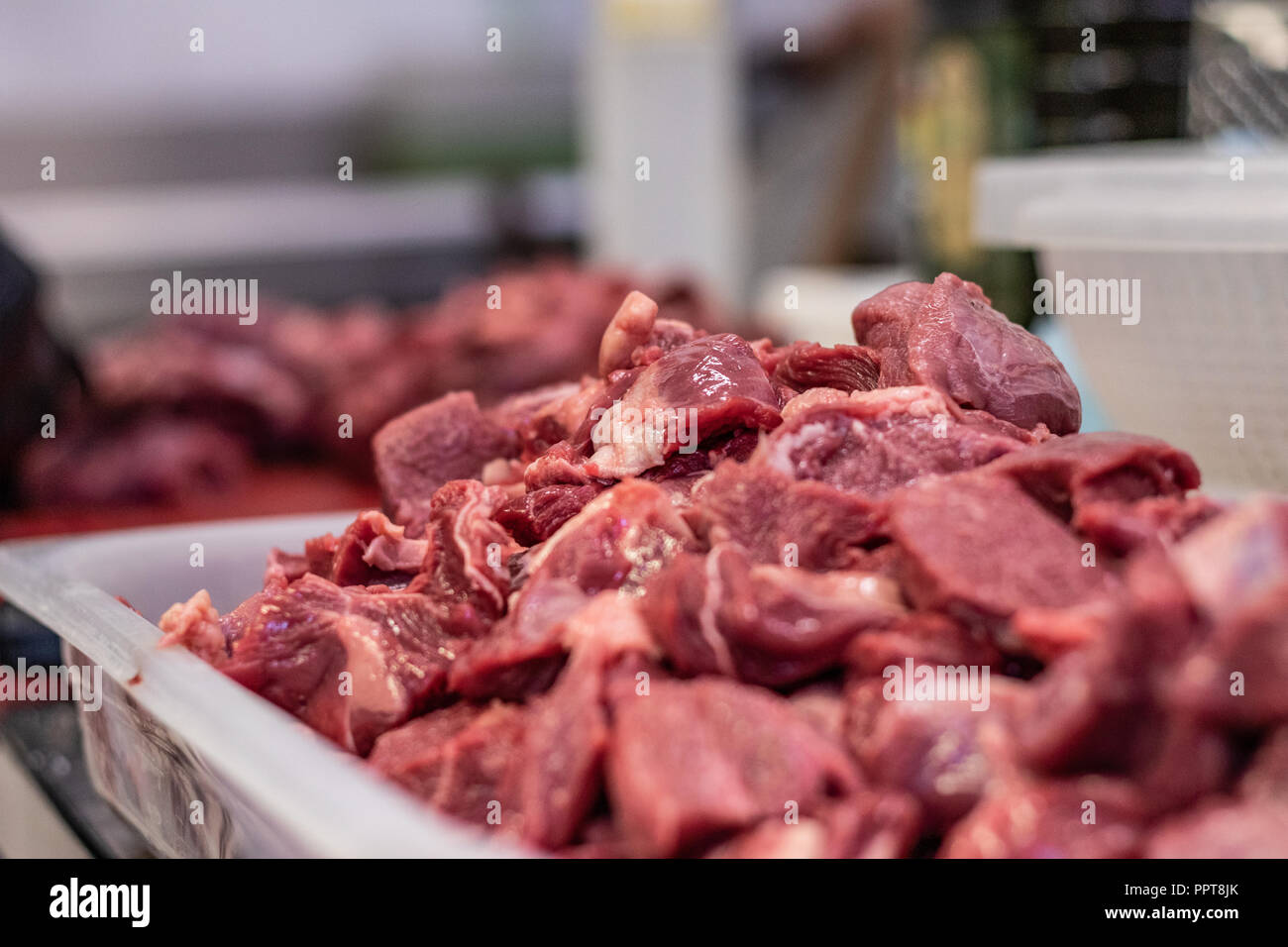 Gourmet chef, preparing a charity dinner in an Italian restaurant in Rome, Italy. Steaks, chops, turkey, and fillets for the homeless on Christmas. - Stock Image
