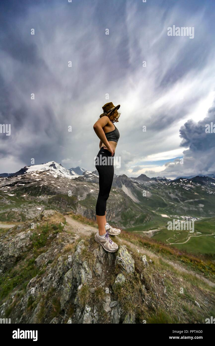 Woman on top of Mountain. Stock Photo
