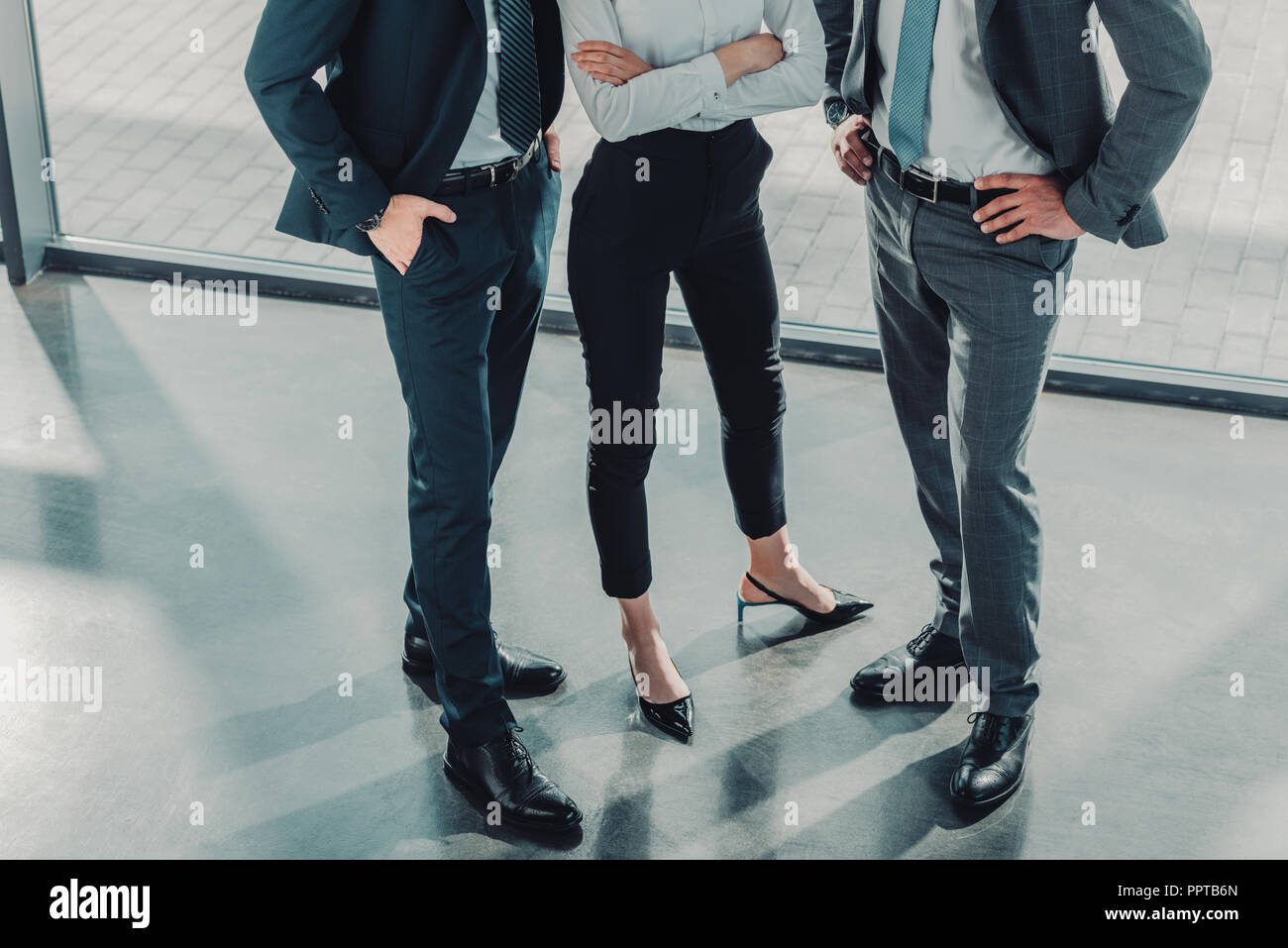 cropped shot of group of male and female business people at modern office - Stock Image