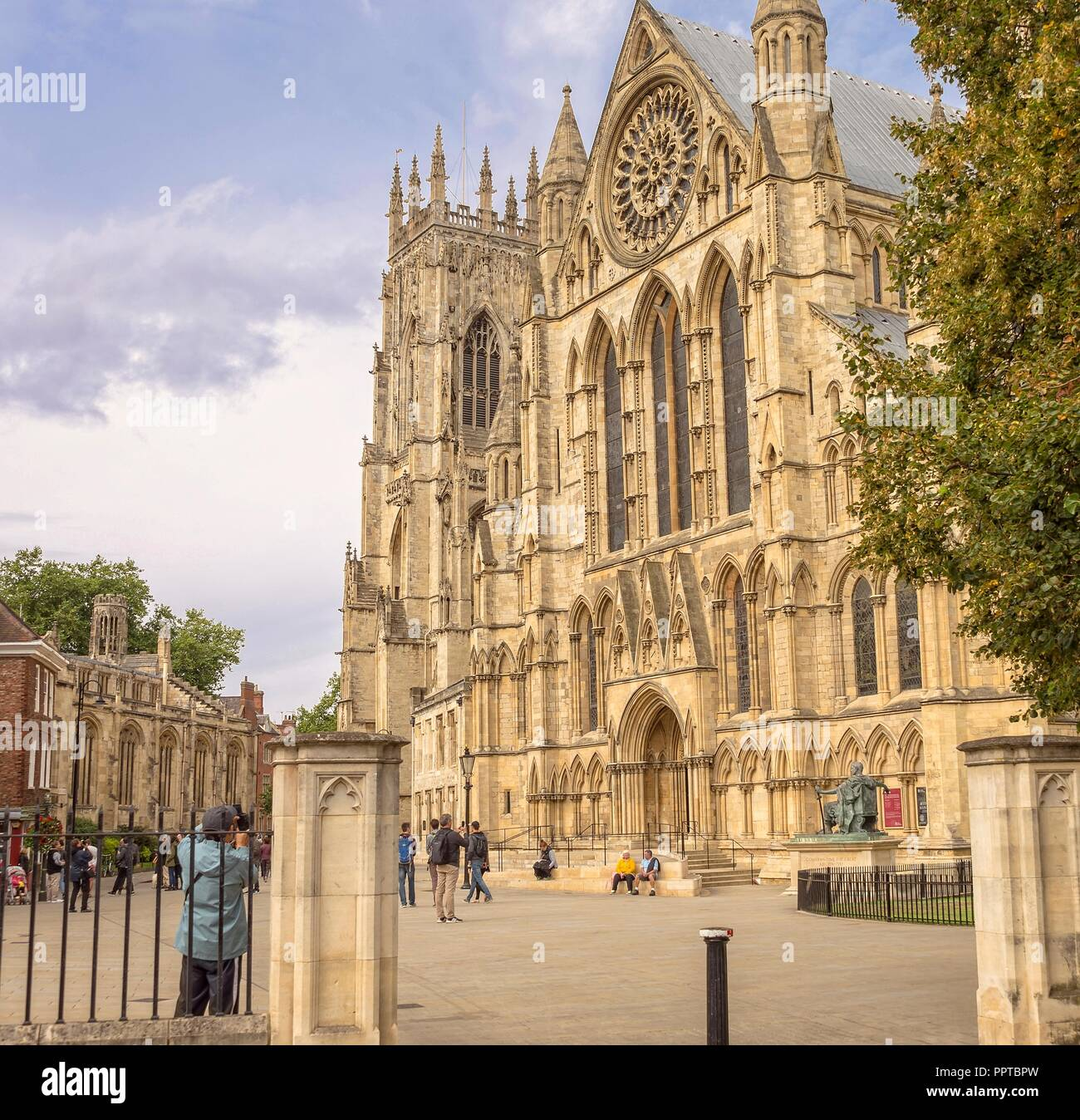 South facing wing of York Minster.  A well-known attraction, tourists gather to take photographs. Stock Photo