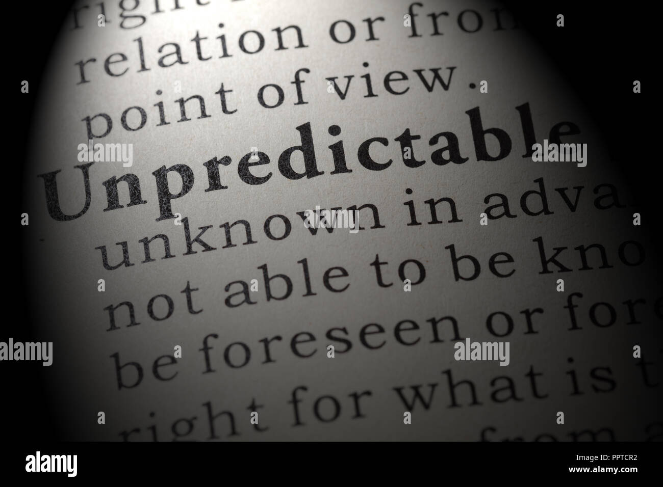 Fake Dictionary, Dictionary definition of the word unpredictable. including key descriptive words. - Stock Image
