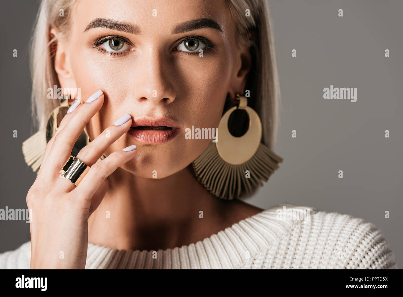 eb42461d466 attractive blonde girl posing in white sweater and big round earrings