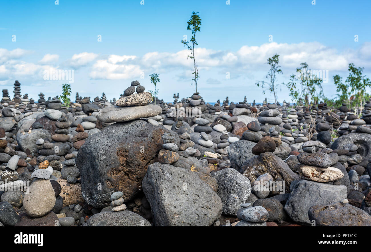 mass of delicately balanced man made stacks or piles of stones stock