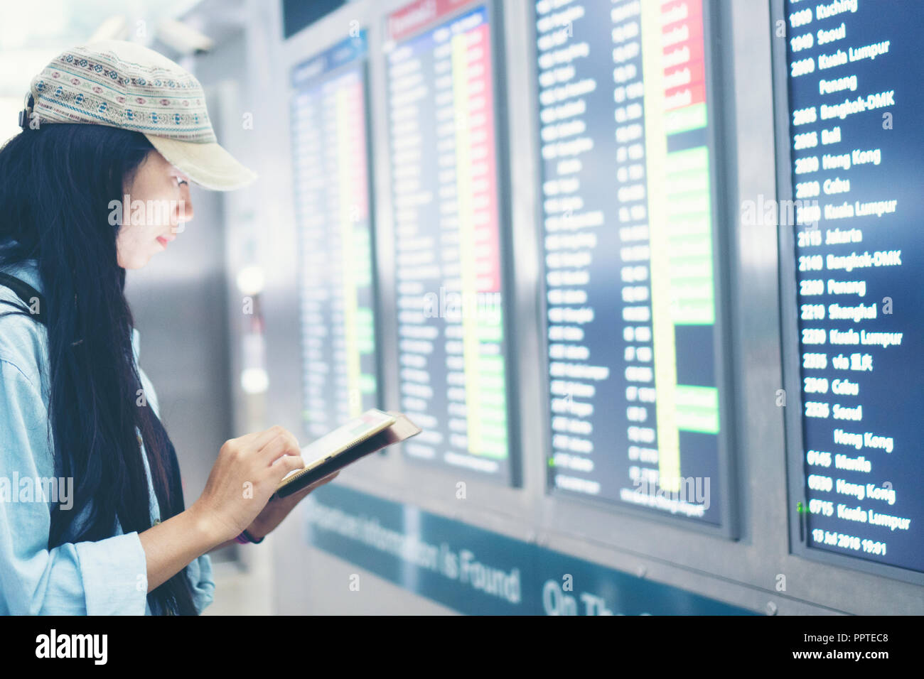 beautiful travel woman using smartphone at airport  Young asian