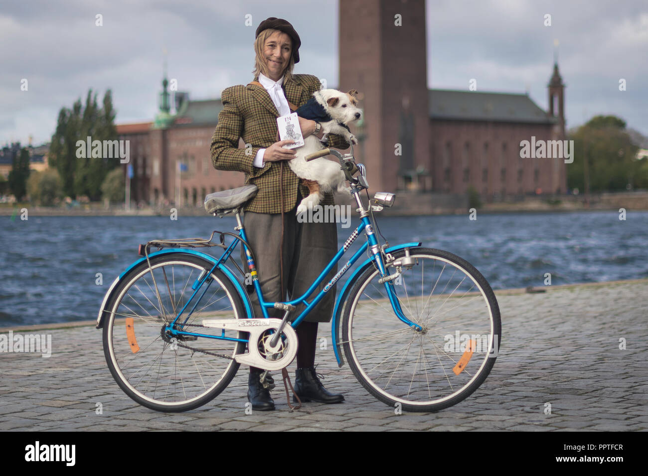 STOCKHOLM, SWEDEN, SEPT 22, 2018: Bike in tweed bicycle tour with vintage bikes and clothes. Before start with backdrop of city hall. Stock Photo