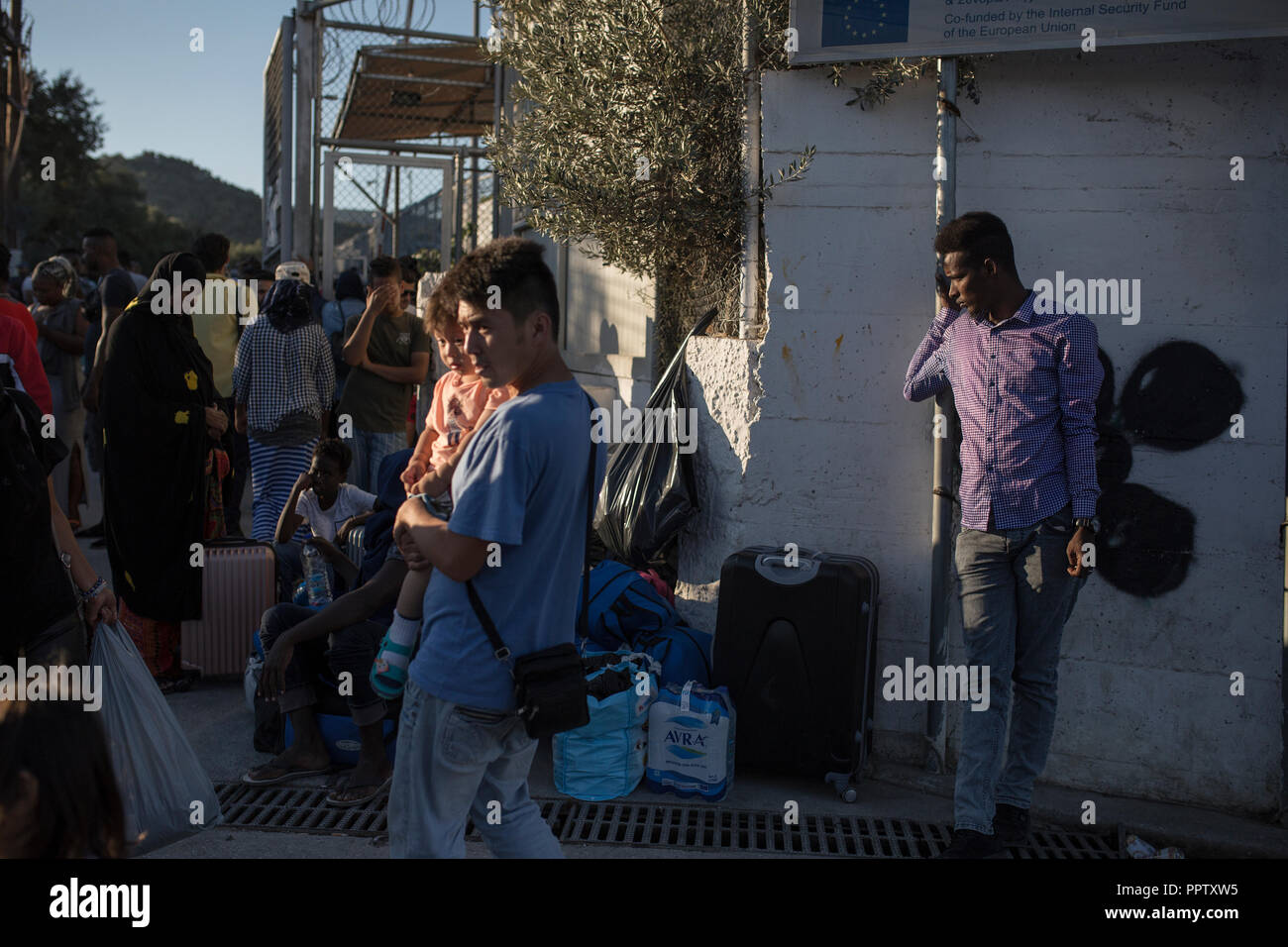 Moira, Greece. 24th Sep, 2018. Refugees are waiting for a bus to take them from the refugee camp Moria to Mitilini. From there they want to take a ship to Athens. Credit: Socrates Baltagiannis/dpa/Alamy Live News - Stock Image