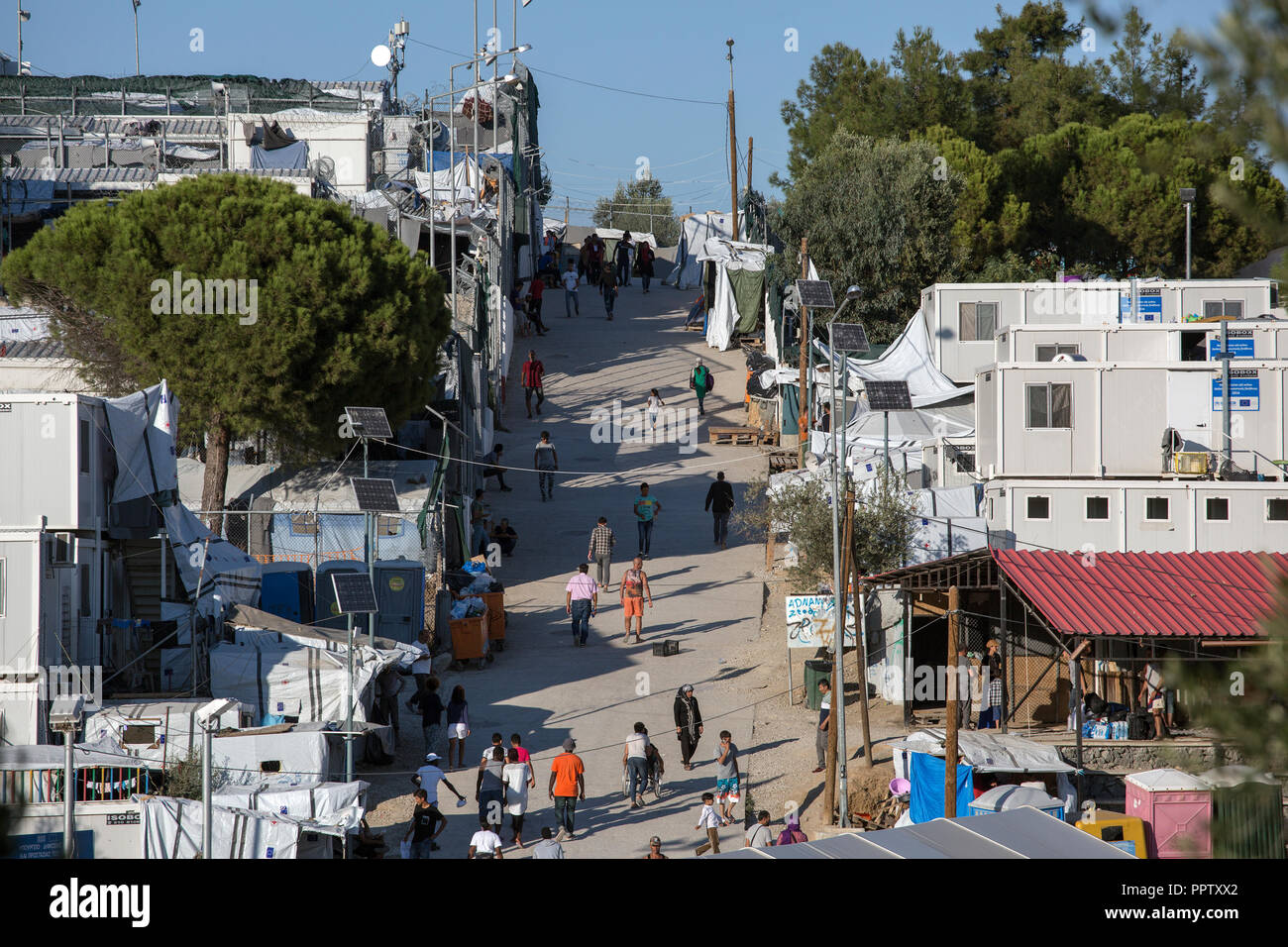 Moira, Greece. 24th Sep, 2018. Refugees walk along a path in the refugee camp Moria. (to dpa 'Moria: The camp of shame on the island of Lesbos' of 28.09.2018) Credit: Socrates Baltagiannis/dpa/Alamy Live News - Stock Image