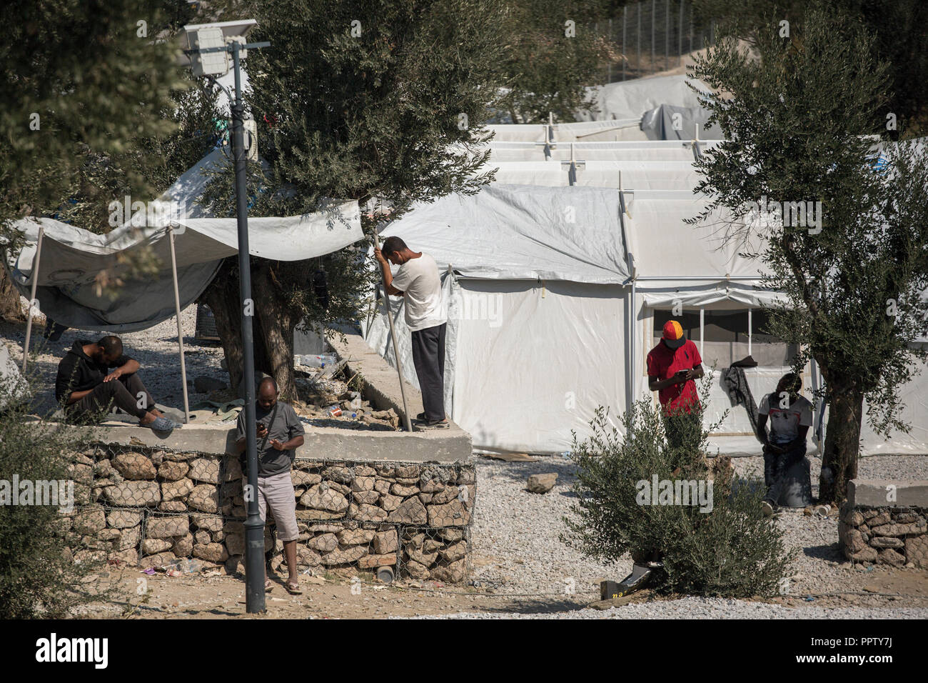 Moira, Greece. 24th Sep, 2018. Refugees and migrants in a temporary camp next to the refugee camp Moria. Credit: Socrates Baltagiannis/dpa/Alamy Live News - Stock Image