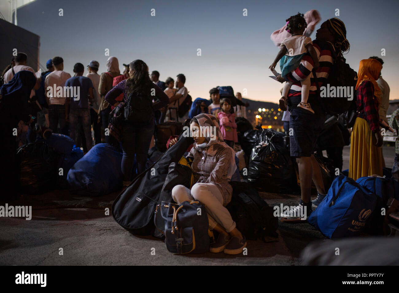 Moira, Greece. 24th Sep, 2018. An asylum seeker is waiting for a ferry from the port of Mitilini to Athens. Credit: Socrates Baltagiannis/dpa/Alamy Live News - Stock Image