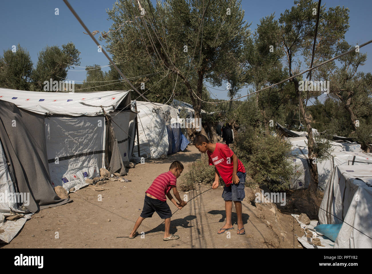 Moira, Greece. 24th Sep, 2018. Children play in a temporary camp next to the refugee camp Moria between tents. Credit: Socrates Baltagiannis/dpa/Alamy Live News - Stock Image