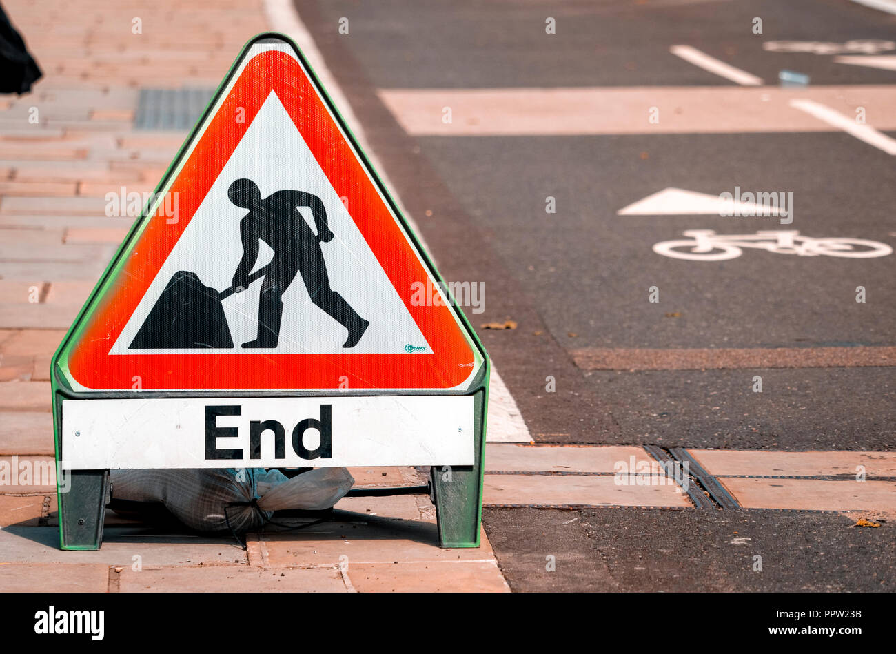 End of Road Works sign next to a Cycle lane - Stock Image