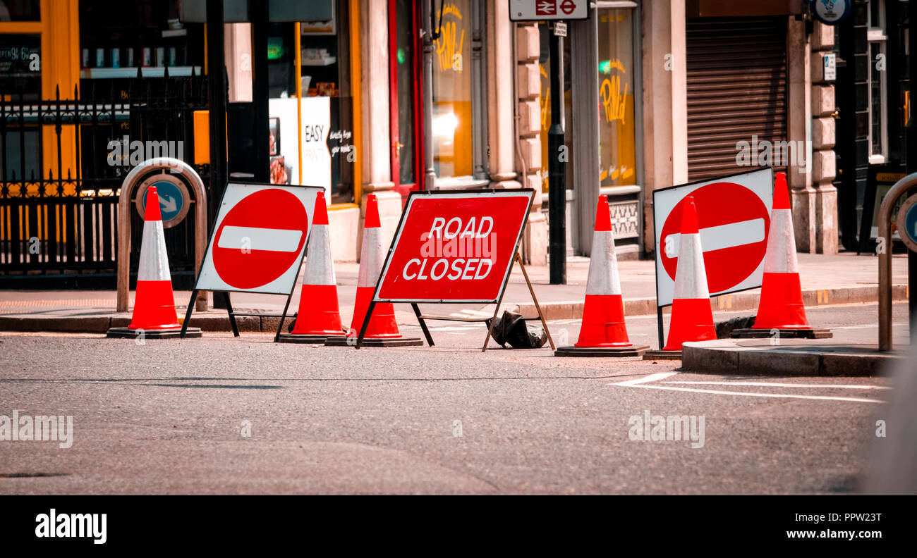 No Entry and Road Closed Signs on busy London street due to repairs. - Stock Image