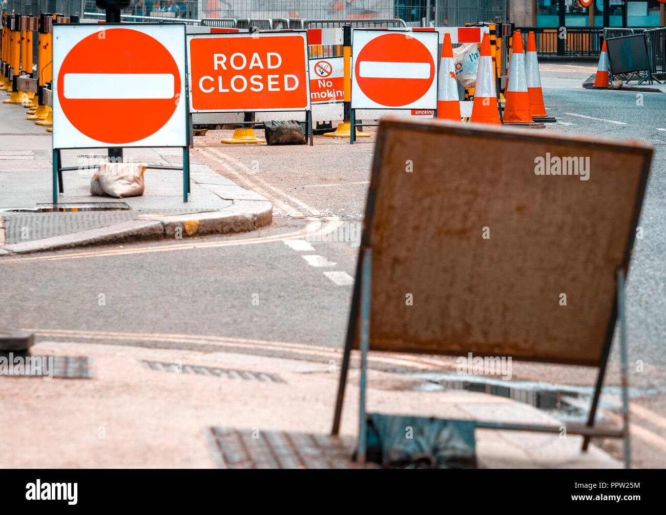 No Entry and Road Closed Signs on busy London street due to repairs. Stock Photo