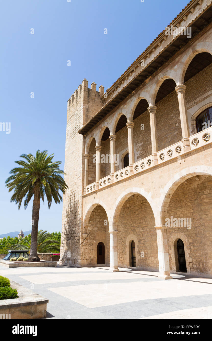 Almudaina Palace exterior view with defence bastion against blue sky, Palma de Mallorca, Balearic islands, Spain. Travel destination - Stock Image