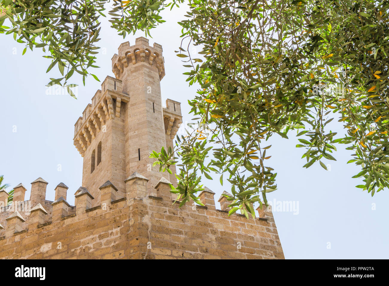 Almudaina Palace exterior walls with defence bastion against blue sky, Palma de Mallorca, Balearic islands, Spain. Travel destination - Stock Image