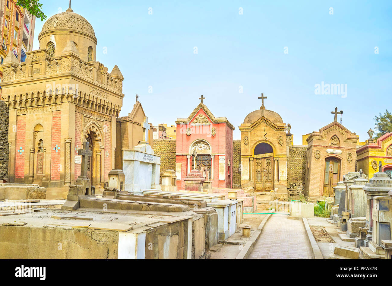 CAIRO, EGYPT - DECEMBER 23, 2017: The old decrepit crypts and tombs in medieval  cemetery in Coptic district, on December 23 in Cairo - Stock Image