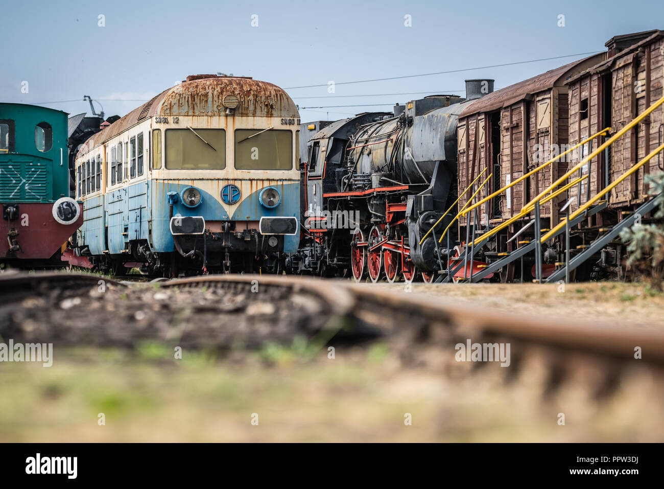 Jaworzyna Slaska, Poland - August 2018 : Old disused blue and yellow passenger train on the side track in the Museum of Industry and Railway in Silesi - Stock Image
