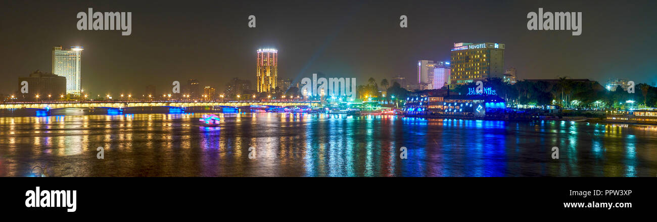 CAIRO, EGYPT - DECEMBER 23, 2017: The Corniche embankment is the best place for night promenades with great view on illuminated hotels and restaurants - Stock Image