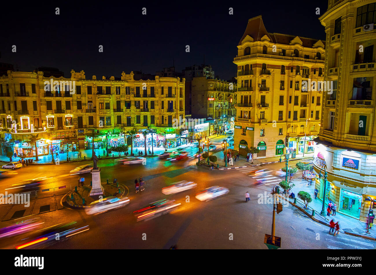 CAIRO, EGYPT - DECEMBER 23, 2017: The fast paced life of Talaat Harb Square with bright stores' showcases, numerous cars and chaotic pedestrian moveme - Stock Image