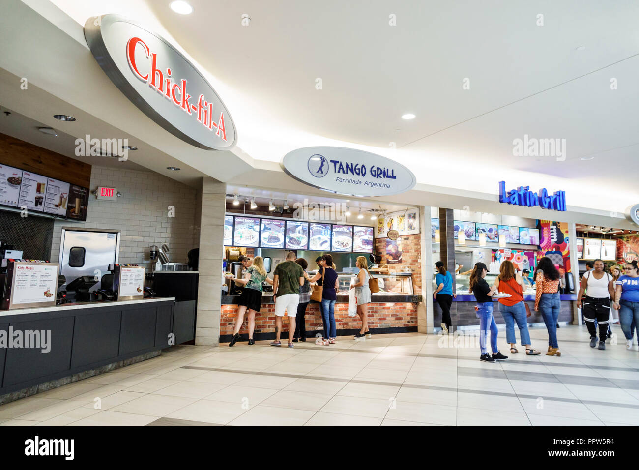 Miami Florida Kendall Dadeland Mall shopping food court plaza Chick-fil-A closed Sunday Sundays Tango Grill Latin Grill counters - Stock Image