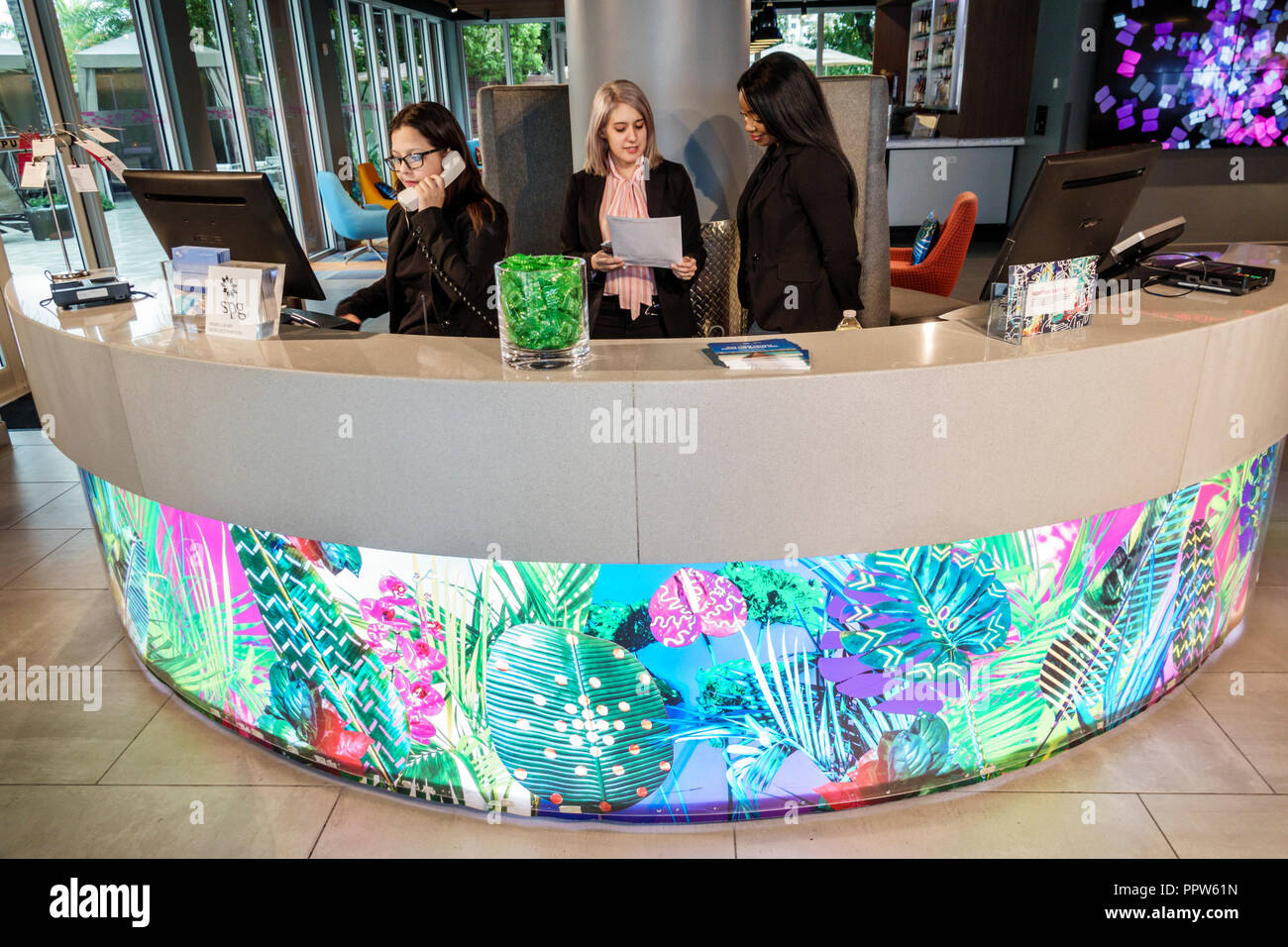 Miami Florida Kendall Aloft Miami Dadeland hotel lobby front reservations desk woman employee manager - Stock Image