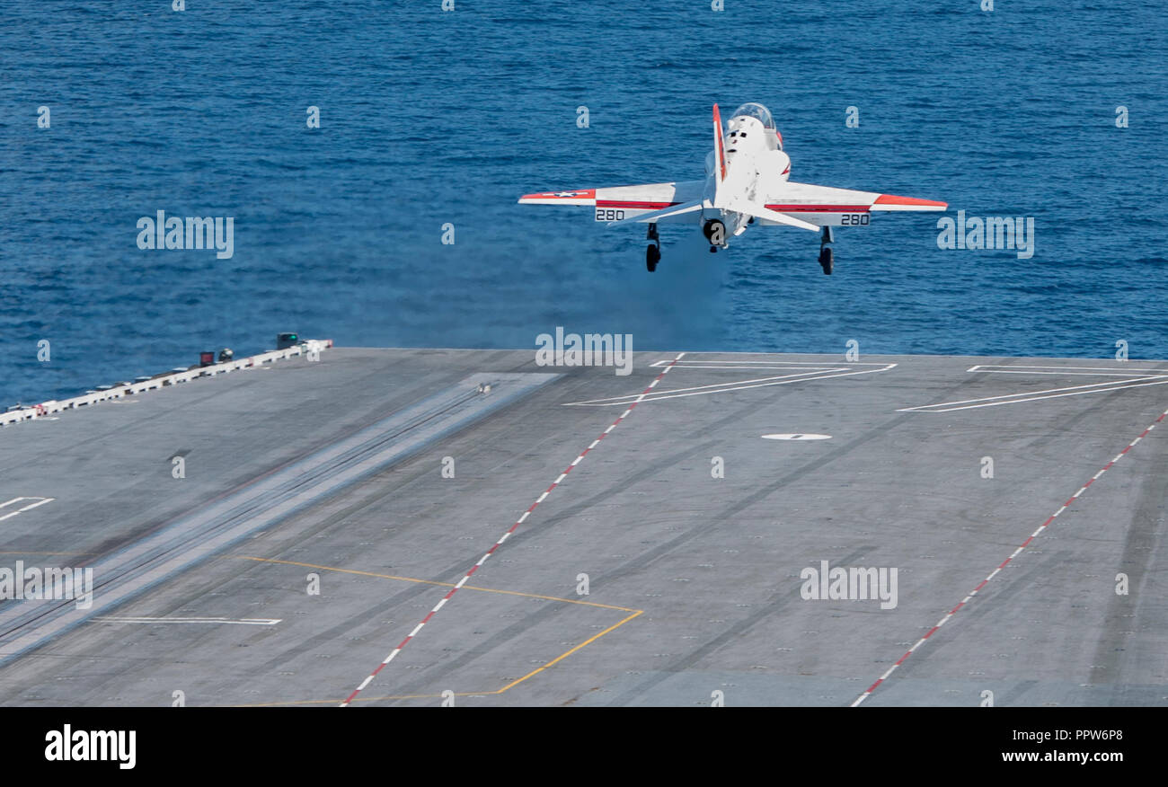 180923-N-ET513-0094 ATLANTIC OCEAN (Sept. 23, 2018) A T-45C Goshawk, assigned to Training Air Wing (TW) 1, launches from the flight deck aboard the aircraft carrier USS George H.W. Bush (CVN 77). GHWB is underway in the Atlantic Ocean conducting routine training exercises to maintain carrier readiness. (U.S. Navy photo by Mass Communication Specialist 3rd Class Kallysta Castillo) - Stock Image