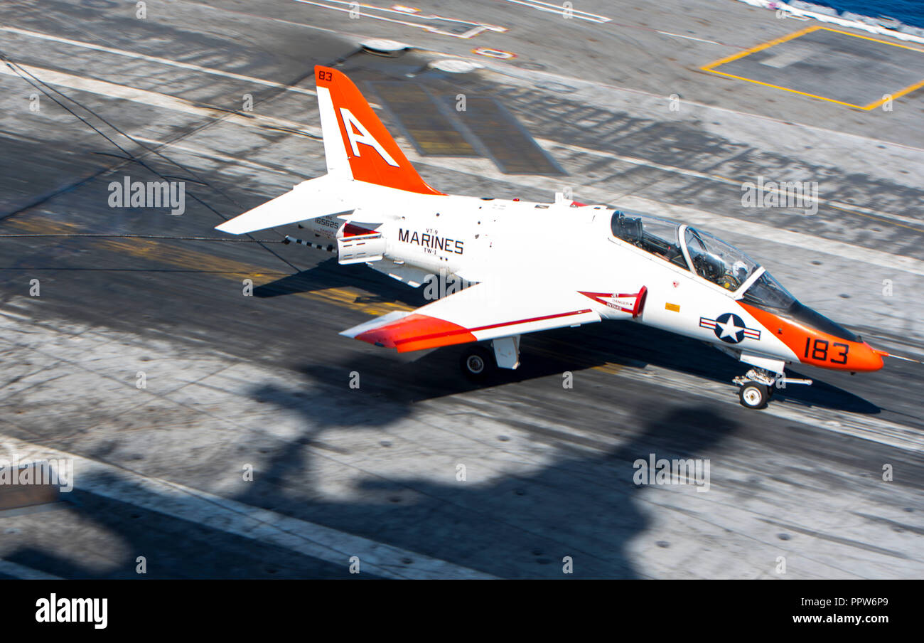 180923-N-ET513-0040 ATLANTIC OCEAN (Sept. 23, 2018) A T-45C Goshawk, assigned to Training Air Wing (TW) 1, lands on the flight deck aboard the aircraft carrier USS George H.W. Bush (CVN 77). GHWB is underway in the Atlantic Ocean conducting routine training exercises to maintain carrier readiness. (U.S. Navy photo by Mass Communication Specialist 3rd Class Kallysta Castillo) - Stock Image