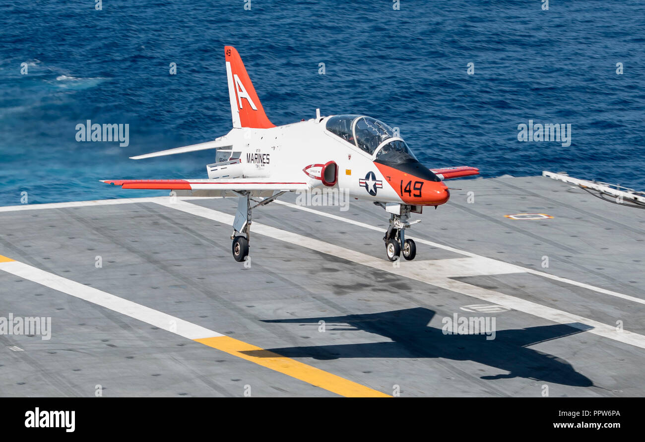 180923-N-ET513-0019 ATLANTIC OCEAN (Sept. 23, 2018) A T-45C Goshawk, assigned to Training Air Wing (TW) 1, lands on the flight deck aboard the aircraft carrier USS George H.W. Bush (CVN 77). GHWB is underway in the Atlantic Ocean conducting routine training exercises to maintain carrier readiness. (U.S. Navy photo by Mass Communication Specialist 3rd Class Kallysta Castillo) - Stock Image