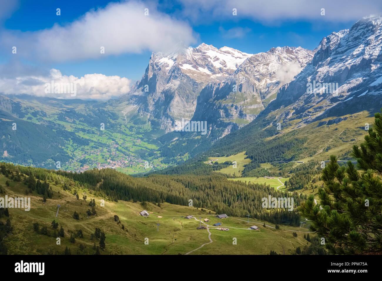 View from Kleine Scheidegg towards Grindelwald (Berner Oberland, Switzerland). The Kleine Scheidegg is a mountain pass and means minor watershed - Stock Image