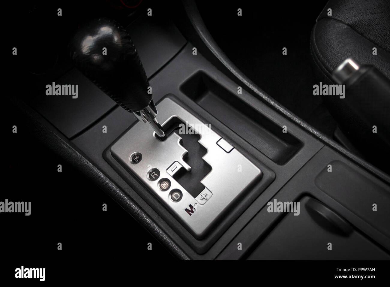 Car interior with semi-automatic transmission gear knob