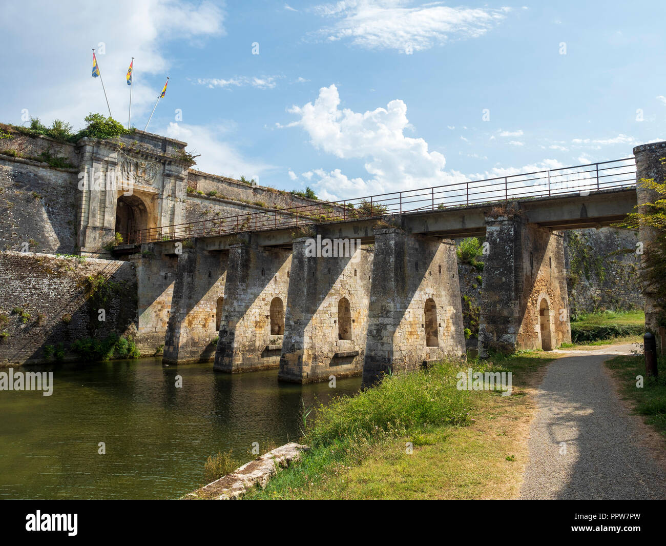 The Royal Gate and bridge stepping over moats, Citadel, Le Chateau d'Oleron, France. - Stock Image