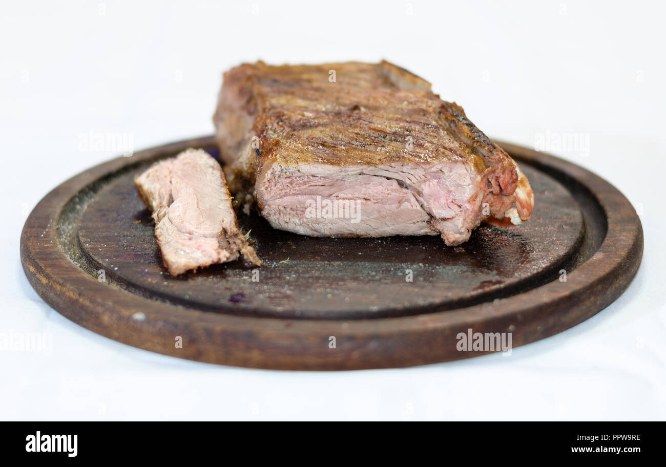 Delicious beef steak on wooden table, close-up - Stock Image