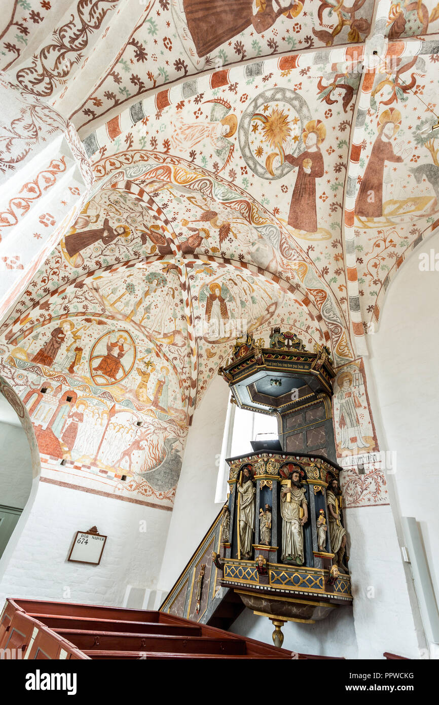 frescos and pulpit in the Fanefjord Church, by the Elmelunde Master - Stock Image