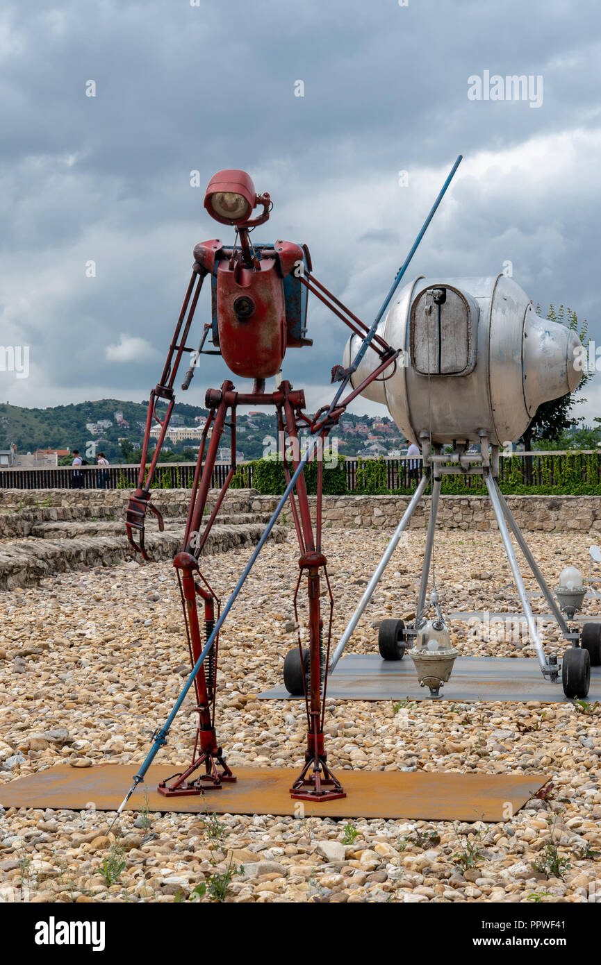 Contemporary art installation of a red robot and spacecraft scanning earth surface in Budapest, Hungary - Stock Image